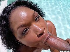 This black beauty gets in the water and splashes around for our amusement. It looks like she is having a lot of fun. That ass shakes gloriously. Her man grabs that booty and spanks it hard. Now she's horny, so she wants to suck his big, throbbing black pecker. She sucks him until he's about to cum.