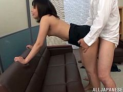 An Asian babe in office clothes gives a blowjob to her boss. Then she lifts a skirt up and gets her pussy licked by a boss' assistant. After that the girl gets banged from behind.