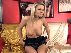 Luscious blonde girl wears sexy black dress. She exposes her tits and then slides her hand between her legs. A bit later, sexy girl sleeks smooth dildo into her wet pussy hole.