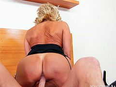 Experienced blonde mom Tara Holiday looks gorgeous wearing black lingerie and nylon stockings. She performs good quality skills in exciting Naughty America porn video. Check this out.
