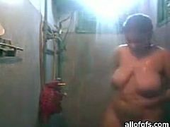 Slutty dark haired chick with fat ass and droopy tits takes off her clothes and takes a shower. Have a look at this slut in The Indian Porn sex video.