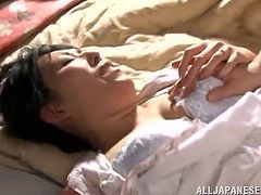 This mature Japanese beauty wakes up horny, and she wants some morning sex with her husband. He tears open her blouse and sucks her nipples before moving on to eating her pussy.