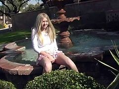 Click to watch this blonde doll, with big gazongas wearing a pink miniskirt, while she touches herself outdoors in a public place.