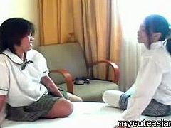 They are a pair of barely legal Asian cuties and they are wearing their schoolgirl outfits for this scene. They get together in front of the camera and start to play.