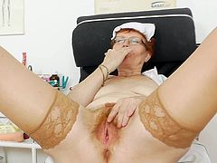 Her cramped hairy twat is being enlarged by a stiff toy during nasty work shift at the hospital