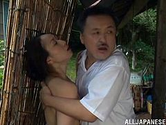 Amazing Japanese milf washes her body in a shed. Some man sees her and decides to take his chance. He strokes the woman's wet body and then drills her pussy from behind.
