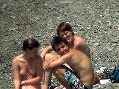 Voyeur has a great experience by spying nude babes at the beach