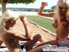 Horny blonde Dido Angel is having fun with her BG on the poolside. The hotties make out passionately and then show their pussy-licking skills to each other.