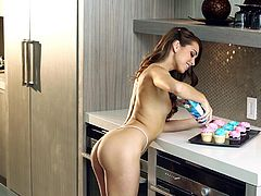 Have a blast watching this long haired brunette, with a nice ass wearing sexy lingerie, while she touches herself erotically in the kitchen.