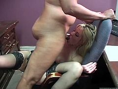 Naughty secretary gives her boss eager blowjob in a presence of voyeur