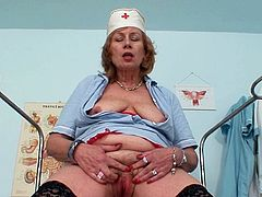 Horny head nurse enjoys some time alone in the cabinet, enough for a quick pussy stroking