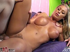 Naughty and well shaped blond head Nicole Aniston has big fake boobs and nice ass. She gets her wet snatch fucked hard from behind.