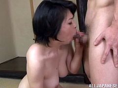 A lustful Asian woman gets her juicy tits licked by a younger guy. He also licks her hairy pussy. Later on this mature slut gets fucked in a doggystyle and a missionary positions.