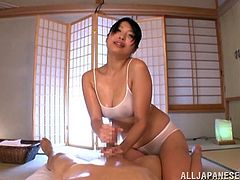 Masturbate watching this Japanese cougar, with a nice ass wearing a sexy uniform, while she touches and licks a guy's rocket covered in oil.