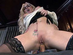 Captivating blonde Christie Stevens wearing stockings is getting naughty with some man in an office. She gives him a blowjob and then leans against a desk and gets her vagina drilled from behind.