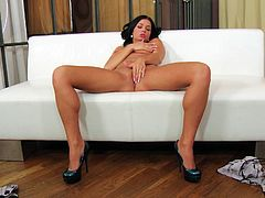 Check this brunette doll, with a nice ass wearing sexy lingerie, while she digitally stimulates herself over a couch in a glamorous way.