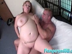 Make sure you see this! A blonde BBW, with giant gazongas and a shaved pussy, goes hardcore with a naughty fellow and moans loudly.