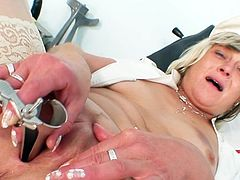 The head nurse enjoys some free time by slamming her cunt with a big toy