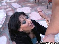 Check out this hardcore scene where the sexy milf Lezley Zen sucks on this guy's big cock outdoors before taking her into her house to get fucked.