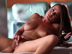Have fun with this heart stopping lesbian scene where the beautiful brunette Rahyndee James shows off her amazing body before playing with her pussy.