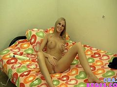 Sweet slim blonde Aimee Addison is doing a performance in front of a webcam. She shows her amazing body for the cam and then lies down on the bed and plays with her pussy.