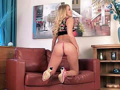 Click to watch this blonde babe, with a nice ass wearing a pink thong, while she touches herself softly in an erotic solo model video.