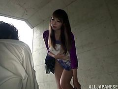 Delightful Emiko Ejima lifts a skirt up and sits down on guy's face. He licks Emiko's delicious and shaved pussy with pleasure. Then the girl gets fucked on an asphalt.