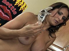 She looks staggering while playing with her cramped holes and pissing during her nasty masturbation