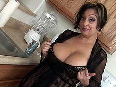 She looks amazing with those huge boobs exposed while slamming her cunt with her naughty toy