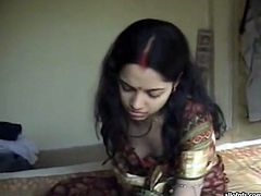 Dark haired young bitch takes her top off and shows her boobs getting her nipples sucked. Have a look at this chick in The Indian Porn sex clip.