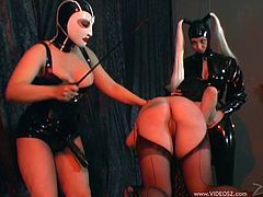 Check out how two dominant bitches all dressed in latex toy with a submissive slut in this BDSM lesbian threesome! Check it out!
