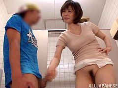 Sexy Japanese milf Nanako Mori is playing dirty games in a public WC. She masturbates her pussy and then a guy enters the bathroom and offers the slut to jerk his dick off.