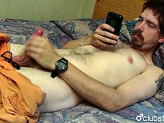 Unshaved straight guy Mike wanking his hard schlong hard while watching a porn in his cell phone.See how he grabs his cock and jerks it off nicely here on Club Stroke!