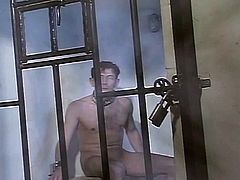 Prison Mistress controls her slave with an iron fist .. and a wet cunt.  She first gives him a huge strip tease against the bars and makes him eat out her pussy and fuck her
