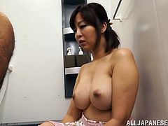 Share this with your friends! Watch an Asian brunette, with giant jugs wearing a skirt, while she licks a hairy ass after sucking a cock.