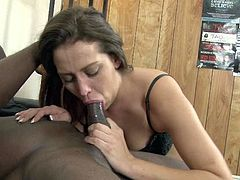 Brown haired white girl in lingerie sits on the floor and desirably sucks BBC. Cutie gives sloppy blowjob getting her mouth fucked by that black rod.
