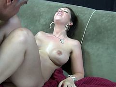 Melina takes over. She gives him head then crawls on top and nearly smothers him with her huge tits as she grinds away on his hard cock.