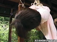 This Japanese girl is tied up by her master and suspended in the air. He keeps changing the restrains, putting her legs up in the air as well. He treats her like a puppet.