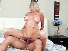 This cougar is an experienced slut when it comes to pleasing men. She sucks this young stud's cock with unbridled passion. Then she rides his rock hard dick reverse cowgirl style.