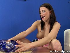 Make sure you see this! A brunette babe, with a nice ass and natural jugs, while she uses big instruments to reach a lovely orgasm.