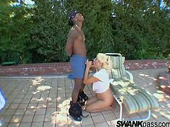 Interracial outdoors scene with the busty mature Dana Hayes