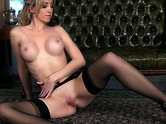 Share this with your friends! A Blonde babe, with a nice ass wearing nylon stockings, touches herself in a glamorous and erotic way.