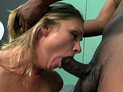 This skinny bitch gets her motherfuckin' tight-ass snatch fucked by a black dude that blasts a hefty load on her fuckin' face!