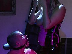 A stunning blonde chick in a leather dress ties the guy up. She sucks his dick passionately and then rides it like an Amazon girl.