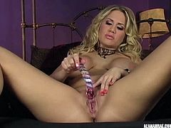Stunning blonde babe Alanah Rae sits with her long legs wide spread and reveals her juicy pussy. She plays with a glass dildo and moans while pleasuring herself.