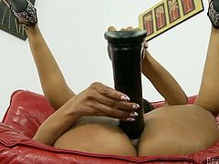 Ardent and naughty slut stretches her pussy with big dildos. Starting with smaller ones, at the end she inserts really big and fat dildo inside.