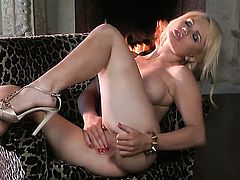 Alexis Ford with gigantic hooters and hairless beaver gives pleasure to herself with vibrator