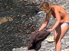 Nude babes with sexy forms are making the guy to feel horny while spying on them at the beach