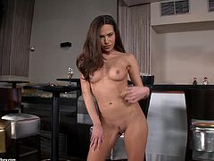 This hottie goes into the kitchen, peels off her clothes and shows off her pierced nipple before she gets out the toy and plays.