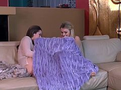Dani Daniels and Natalia Starr snuggle and kiss